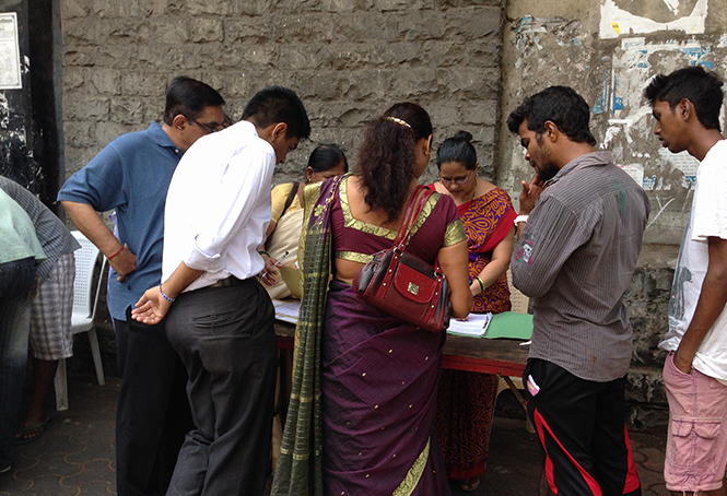 Voters crowd around an election information desk in Mumbai's Colaba Causeway. Photo: Patrick Ward